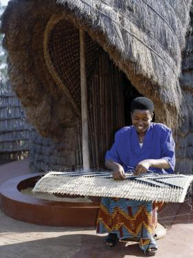 Rwandan Girl Makes Finely Decorated Screen to Partition the Interior of Traditional Thatched House by Nigel Pavitt