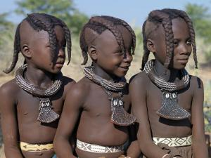 Three Young Girls, their Bodies Lightly Smeared with Red Ochre Mixture, Namibia by Nigel Pavitt