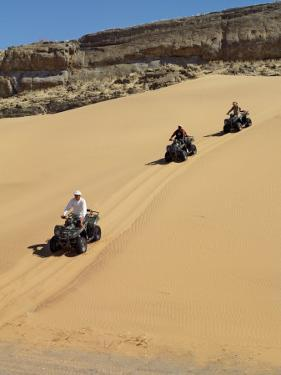 Tourists Set Out on Quad Bikes to Explore Magnificent Desert Scenery of Hartmann's Valley, Nambia by Nigel Pavitt