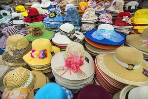 Vietnam, Ho Chi Minh Province, Ho Chi Minh City, Saigon. Hats Galore! a Stall in Saigon Market. by Nigel Pavitt