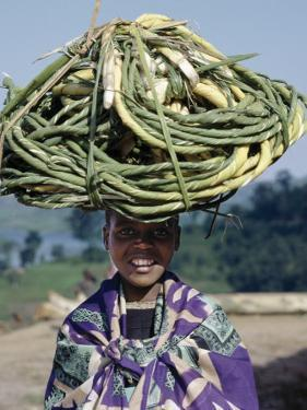 Young Girl Carries Coils of Green 'Rope' to Market Balanced on Her Head by Nigel Pavitt