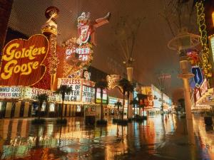 Night Reflections on Wet Street of Neon Signs Along Fremont Street in Las Vegas, Nevada, USA
