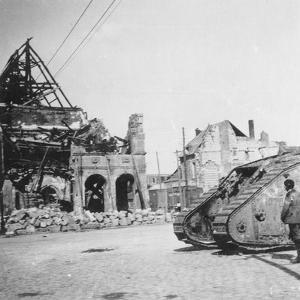 British Tank in Front of Ruined Buildings, Peronne, France, World War I, C1916-C1918 by Nightingale & Co