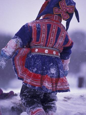 Lapp Child in Traditional Dress, Lappland, Finland by Nik Wheeler