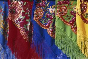 Portugal, Minho Province, Colorful scarves hanging by Nik Wheeler