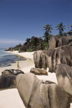 Seychelles, La Digue Island, Man and Child on Beach by Nik Wheeler