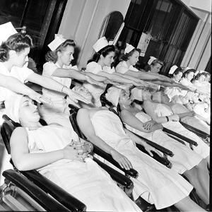 1940S Women Learning Facials and Beauty Techniques at a Beauty School by Nina Leen