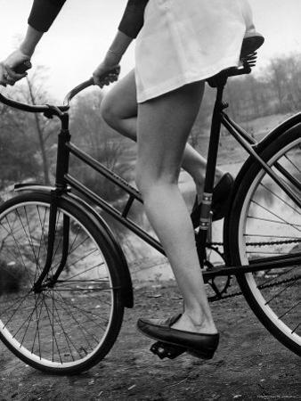 Bicycle Being Ridden by a Typical American Girl