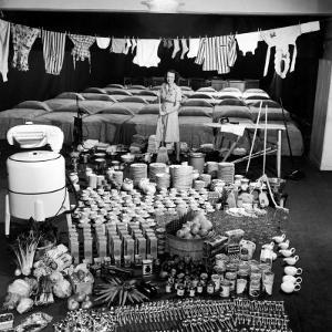 Housewife Marjorie McWeeney with Broom Amidst Display of Her Week's Housework, Bloomingdale's Store by Nina Leen