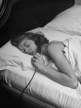 Model Gaby Bouche Talking on the Phone from Her Hotel Room by Nina Leen