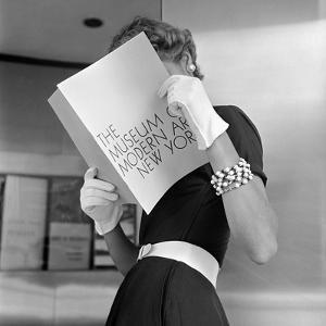 Model Jean Patchett Modeling Cheap White Touches That Set Off Expensive Black Dress by Nina Leen