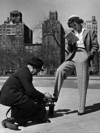 Model Showing Off Slacks as She Reads a First Aid Text Book in Washington Square Park
