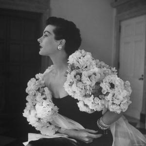 Model Wearing a Flowery Dress While Peering Into the Distance by Nina Leen