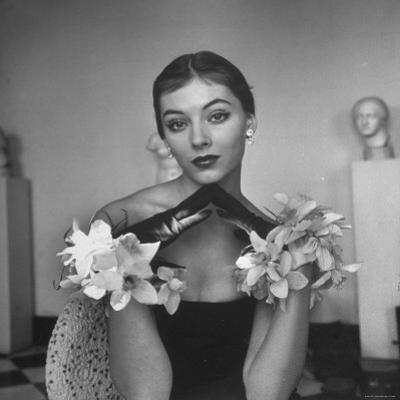 Model Wearing a Flowery Glove While Peering Into the Distance