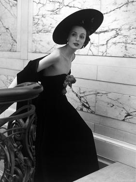 Restaurant Fashions: Cartwheel Hat, Strapless Evening Dress and Stole by Nina Leen