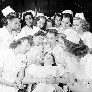 Students at Beauty School Learning Eye Brow and Make Up Techniques. 1940S by Nina Leen