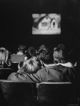 Teenage Couple Necking in a Movie Theater