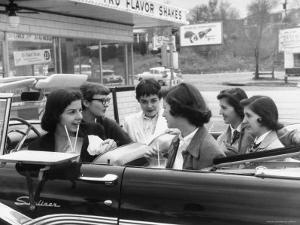 Teenage Girls Enjoying Milkshakes at Drive in Restaurant by Nina Leen