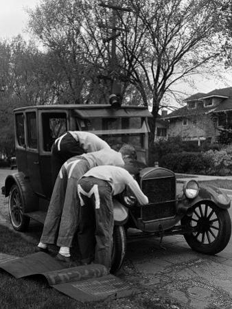Teenaged Boys Working on a 1927 Ford Model T by Nina Leen