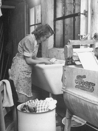The Maid Doing the Family's Weekly Laundry by Nina Leen