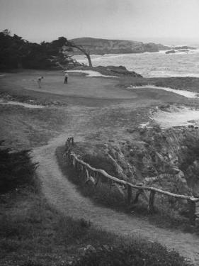 Two Golfers Playing on a Putting Green at Pebble Beach Golf Course by Nina Leen