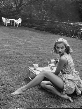 Young Model Wearing a Short, Striped Nightgown with Bottoms Attached Underneath by Nina Leen