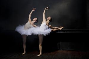 Two Ballet Dancers Stretching by Nisian Hughes