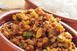 Closeup of a Earthenware Plate with Picadillo, a Traditional Dish in Many Latin American Countries, by nito