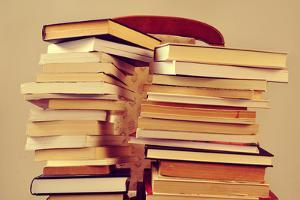 Closeup of Some Piles of Books on a Chair, with a Retro Effect by nito