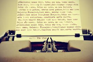 Happy New Year Written in Different Languages with an Old Typewriter, with a Retro Effect by nito