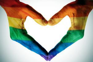 Man Hands Painted As The Rainbow Flag Forming A Heart, Symbolizing Gay Love by nito
