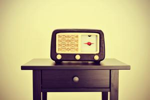 Picture of an Antique Radio Receptor on a Desk, with a Retro Effect by nito