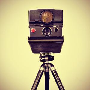 Picture of an Old Instant Camera in a Tripod with a Retro Effect by nito