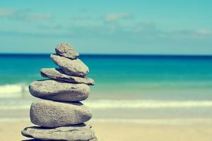 Stack of Balanced Stones in a White Sand Beach, with a Cross-Processed Effect by nito