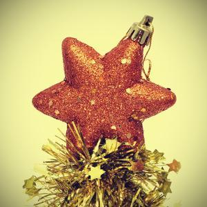 Star-Shaped Christmas Ornament and Golden Tinsel with a Retro Effect by nito