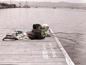 Boy and Girl Laying on Dock Fishing by Nora Hernandez
