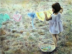 Little Girl Hanging Laundry by Nora Hernandez