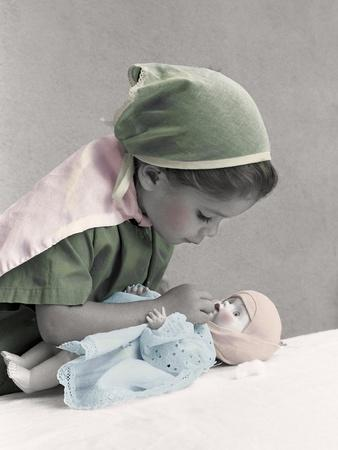Young Girl Dressed as Nurse Tending to a Baby Doll.Get Well