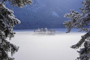 fog over frozen lake by Norbert Maier