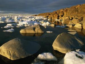 Chunks of Ice and Large Rocks Along the Hudson Bay Shore of Wapusk by Norbert Rosing
