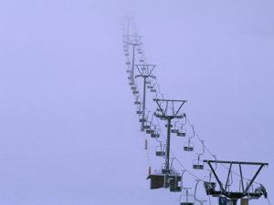 Ski Lift in a Thick Fog at the Seebuck Mtn by Norbert Rosing