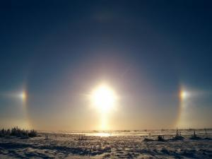 Sundogs Shine Down over the Landscape of Ice and Snow in Churchill, Canada by Norbert Rosing