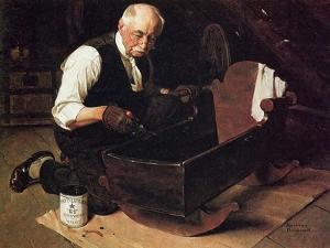 Grandpa's Gift (or Grandfather Varnishing the Cradle; Up in the Garret) by Norman Rockwell
