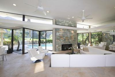 Sunken Seating Area and Exposed Stone Fireplace in Spacious Living Room with View