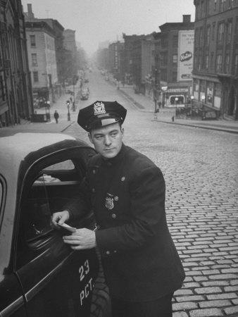 https://imgc.allpostersimages.com/img/posters/ny-patrolman-james-murphy-standing-by-his-23-precinct-squad-car-on-street-of-his-east-harlem-beat_u-L-P3OLFY0.jpg?p=0
