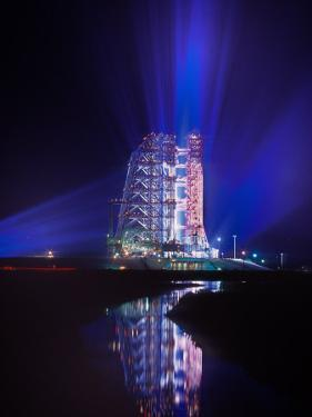 Apollo 11 Sits on its Launchpad the Night before Liftoff to the Moon by O. Louis Mazzatenta