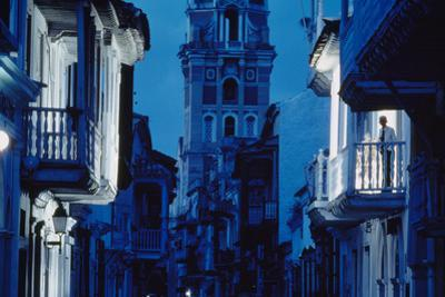 Dusk darkens a block near Cartagena's white-trimmed cathedral. by O. Louis Mazzatenta