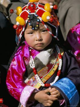 Little Girl Wearing Traditional Amber Jewellery at Yushu, Qinghai Province, China by Occidor Ltd