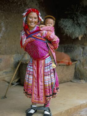 Portrait of a Miao Girl with Baby Carrier, Qiubei, Yunnan, China by Occidor Ltd