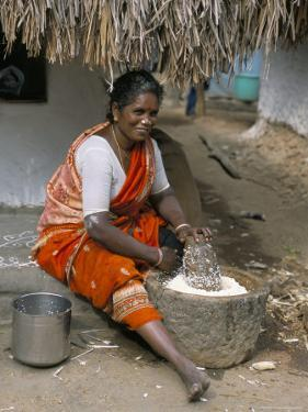 Village Woman Pounding Rice, Tamil Nadu, India by Occidor Ltd